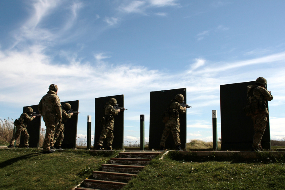 Multinational reservists take part in a shooting competition