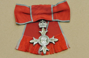 MBE (Member of the most Excellent Order of the British Empire) insignia.