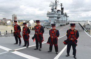 Yeoman Warders from the Tower of London at the top of HMS Illustrious's ramp as she transits the Thames Barrier [Picture: Leading Airman (Photographer) Dean Nixon, Crown copyright]
