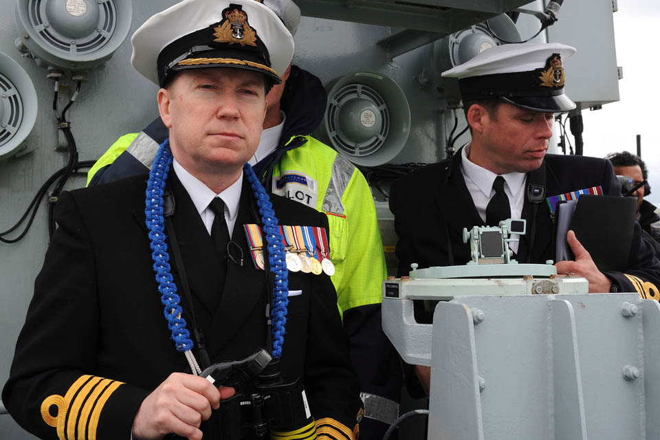 HMS Illustrious's Commanding Officer, Captain Martin Connell, takes charge