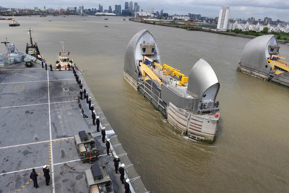 HMS Illustrious transits the Thames Barrier
