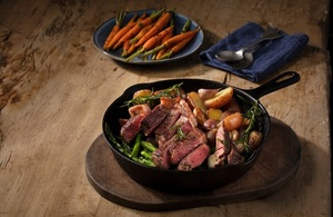 An image of a cooked sirloin steak and vegetables.