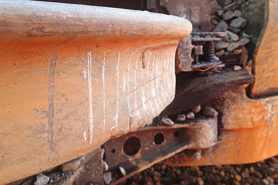 Right-hand leading wheel of third wagon, on its side after the derailment, showing flat spot on wheel tread and false flange