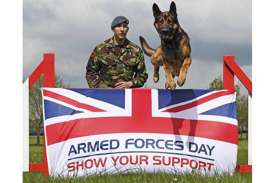 Air dog Borik and his Royal Air Force Police handler