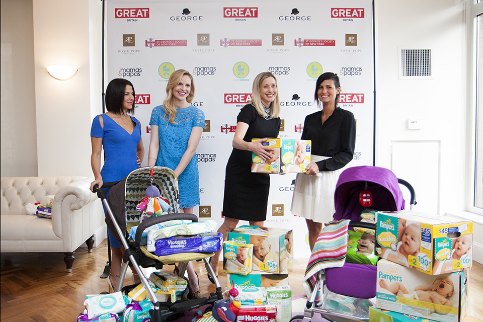 Jessica Seinfeld of Baby Buggy, Rosie Pope, Susan Lopez and Olivia Robinson of Mamas and Papas pose with the donated items.