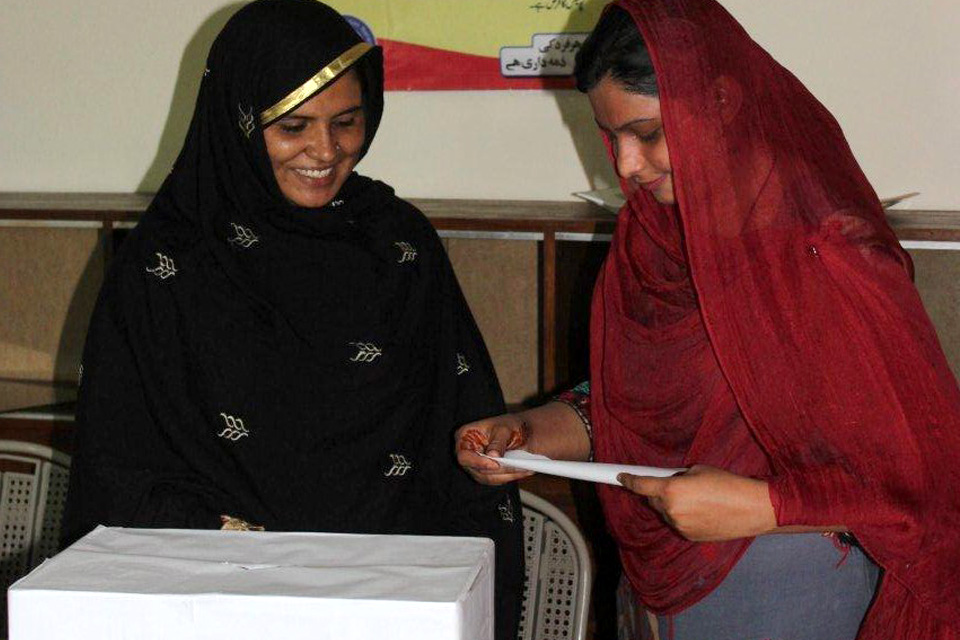 Kausar with Kanwal (in red), an election mobiliser, who encouraged women to register through the voter mobilisation strategy. Picture: DFID Pakistan
