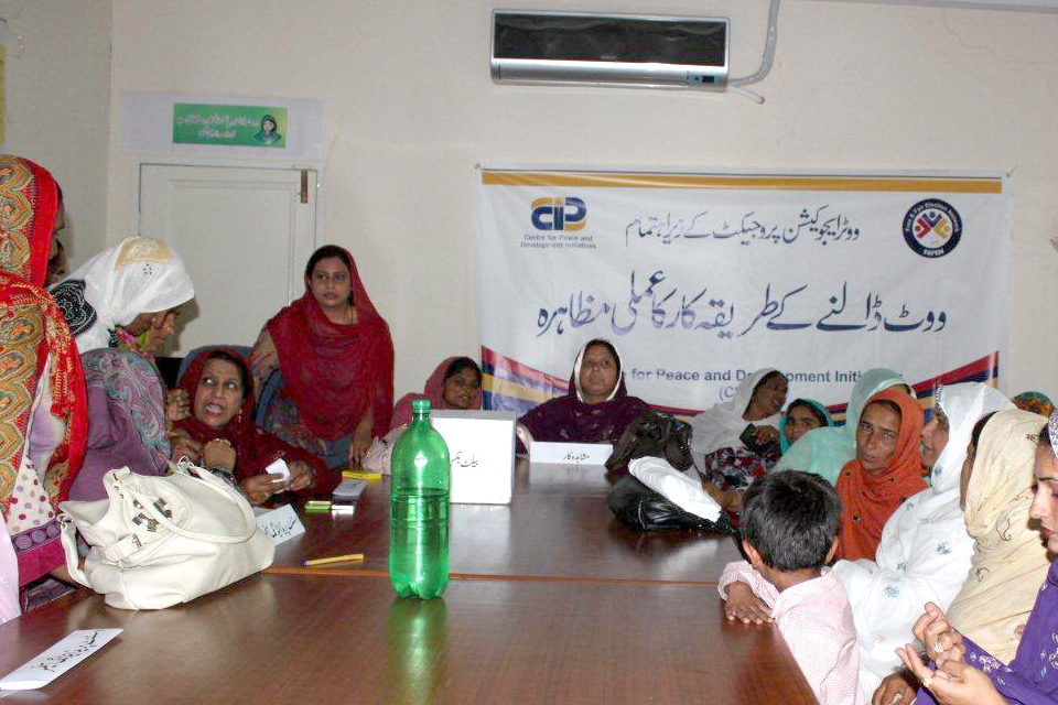 A women's gathering where Kanwal goes through the process on what would take place on election day. Picture: DFID Pakistan