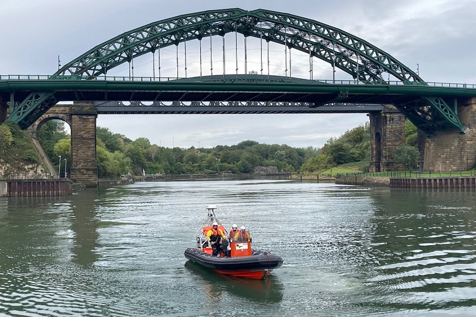 The images shows the EA and police on boat patrols underneath the Wear Bridge.