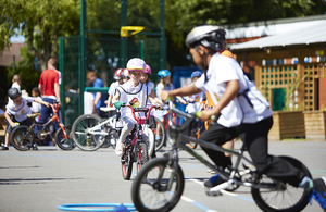 Children learning to cycle.
