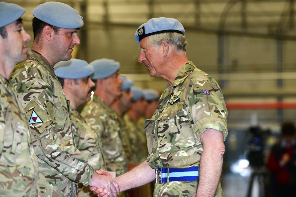 Prince Charles shakes hands with a member of the Army Air Corps