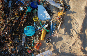 A collection of old straws and other plastic items on a beach. Credit: Marine Conservation Society.