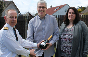 Captain Michael Tarr RN with Petty Officer Mark Trollope and his wife Nic [Picture: Crown copyright]