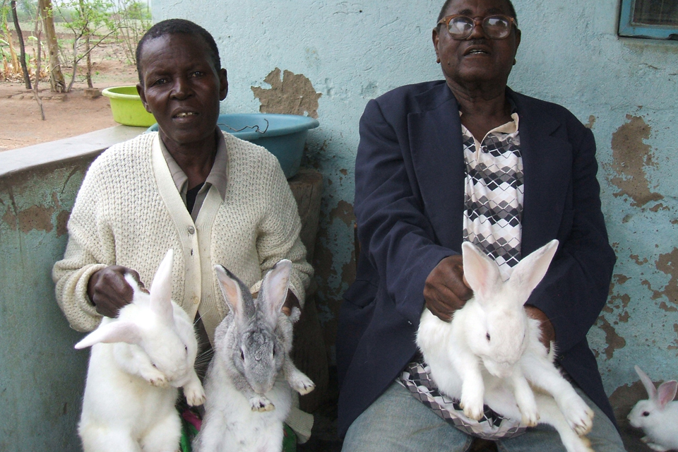Gogo Kerina (left) and her husband holding some of her rabbits. Picture: DFID