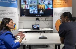 The Home Secretary and Nimco Ali talking to Girlguides