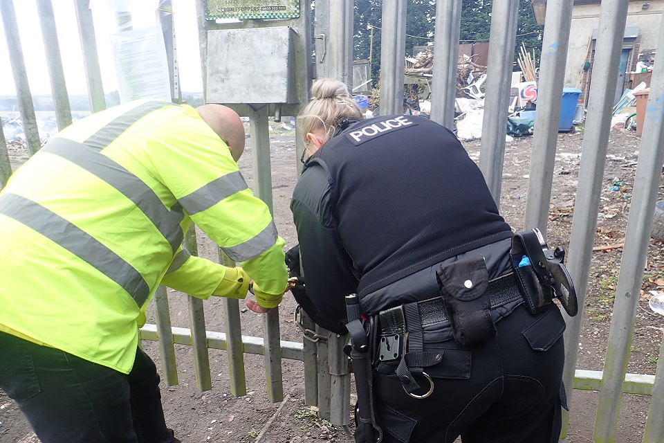 Image shows the Environment Agency and Northumbria Police locking the site gates