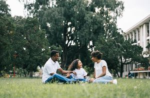 Family in outdoor green space
