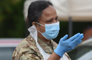 A reservist from the Royal Auxiliary Air Force in support of COVID-19, wearing a mask to show commitment to keeping safe.