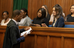 Crown Court usher giving handouts to members of a jury