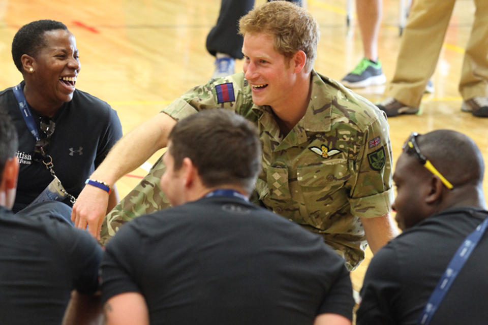 Prince Harry shares a joke with members of the UK Help for Heroes team