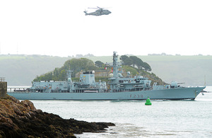 HMS Northumberland, escorted by a Merlin helicopter, arrives in Plymouth [Picture: Leading Airman (Photographer) Ben Shread, Crown copyright]