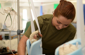 Corporal Jennie Cottrell treats a patient at Camp Bastion military hospital [Picture: Sergeant Barry Pope, Crown copyright]