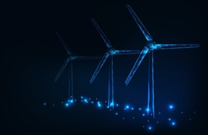 Image depicts a wind farm at night.
