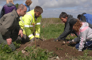 Schoolchildren work alongside an RAF pilot and members of the DIO and the Jon Egging Trust on an excavation on Salisbury Plain [Picture: Crown copyright]