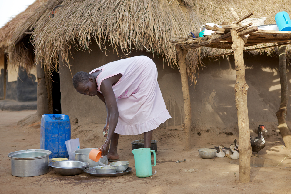 Elizabeth uses the water to wash her pots and pans. Picture: Richard Wainwright/CAFOD