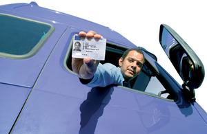 Lorry driver with driver qualification card