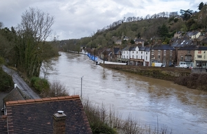 a swollen river in front of a town