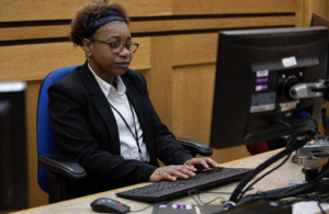 Court clerk working on computer