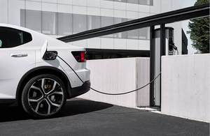 Picture of an electric vehicle being charged.