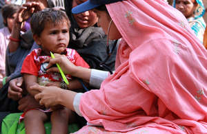 A female doctor with the International Medical Corps examines a young boy at a mobile health clinic in the village of Goza, near Dadu, in Pakistan's Sindh province. Picture: Russell Watkins/DFID