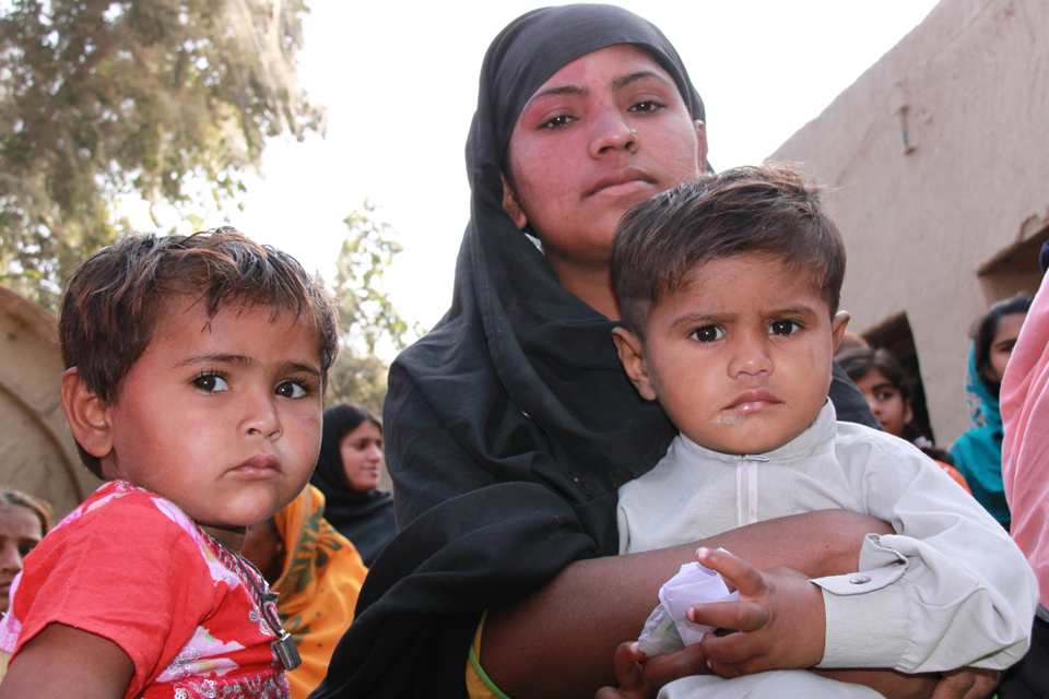 Munawar with two of her children at an International Medical Corps clinic in Sindh province. Picture: Vicki Francis/DFID