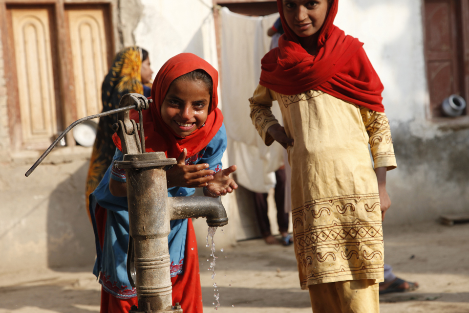 Ten-year-old Shakila drinks clean water from a hand pump in her village. Picture: Russell Watkins/DFID