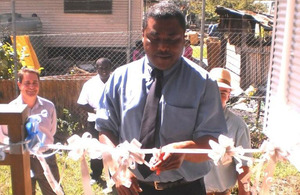 Hon. Chris Laore , cutting the ribbon to officially open Jubilee House
