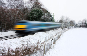 Train racing through the snow