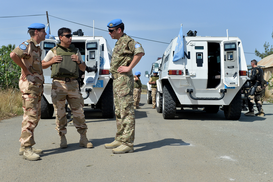 Major Paul Walkley (right) speaks with UN colleagues