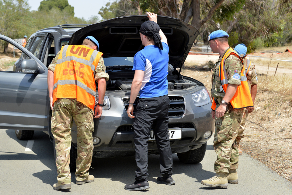 Army reservists conduct a vehicle check