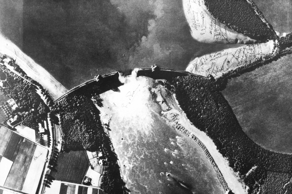 An aerial reconnaissance photograph of the breach in the Mohne dam