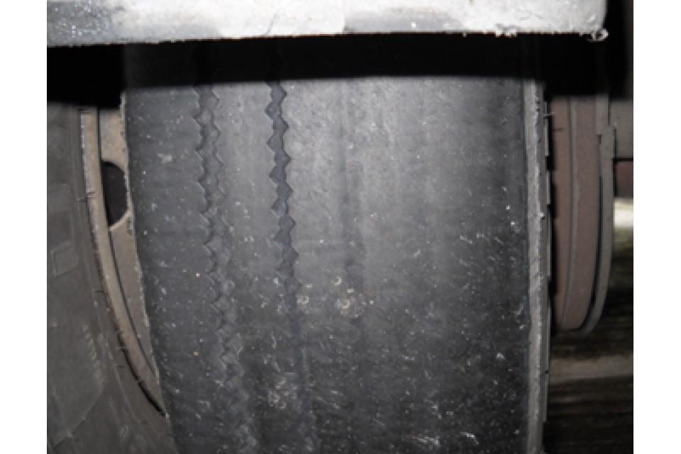 Irregular tread wear, less than 1mm tread depth over less than three-quarters of the tread area