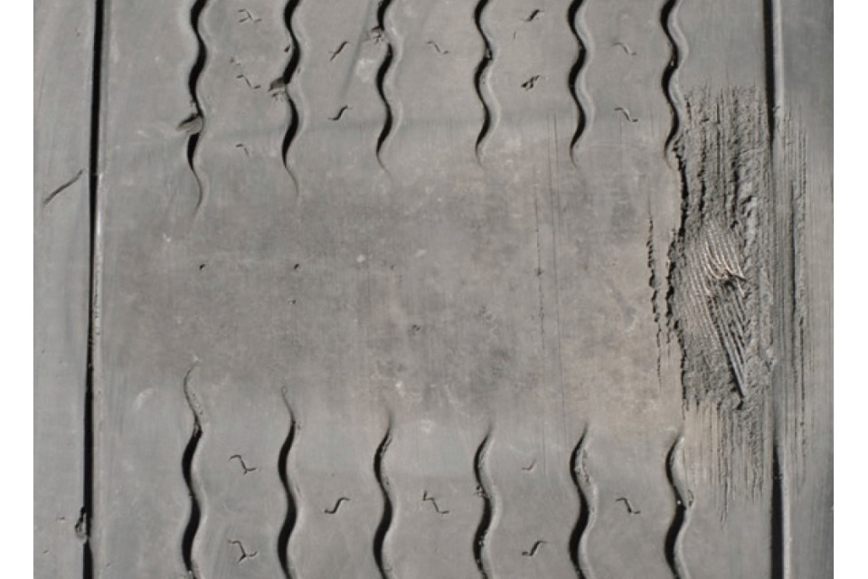 Flat spot, less than 1mm tread across three-quarters of the tyre tread and exposed cords in the tread area