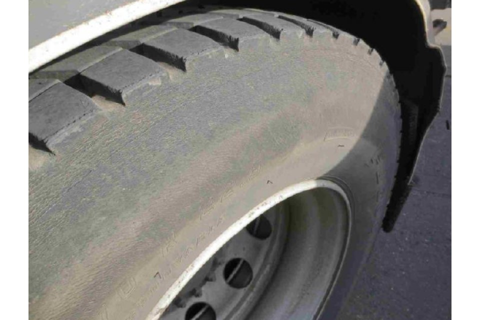 Sidewall heavily abraded with regulatory markings illegible, no cords visible, overheating or other damage evident