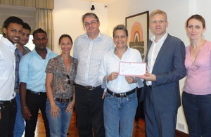 Presentation of a cheque by the British Deputy High Commissioner to the Director of Equal Ground