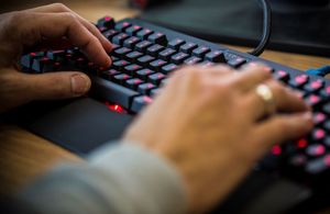 Hands on a keyboard typing.