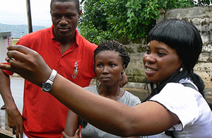 An Oxfam public health advisor checks water quality in Freetown, Sierra Leone. Picture: Oxfam