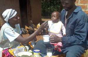 Metrine and her husband Matayo feed their 8-month-old son sweet potato. Picture: HarvestPlus