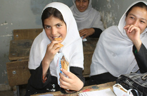 Full of energy: 10-year-old Zarafshan tucks into a biscuit. Picture: WFP