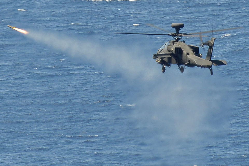 A British Army Apache helicopter fires a Hellfire air-to-surface missile