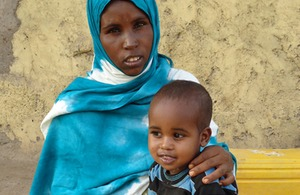 Back to a healthy weight: Two-year-old Ilyas Abdullahi with his mother Faduma. Picture: Ibrahim Bashir/Save the Children